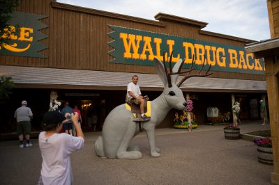 Photo: A tourist sitting on a jackalope at Wall Drug in Wall, SD.