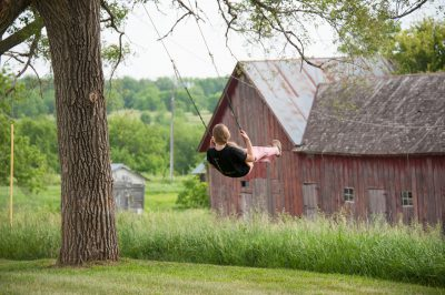 Photo: A teenage girl swings at her farm near Dunbar, Nebraska.