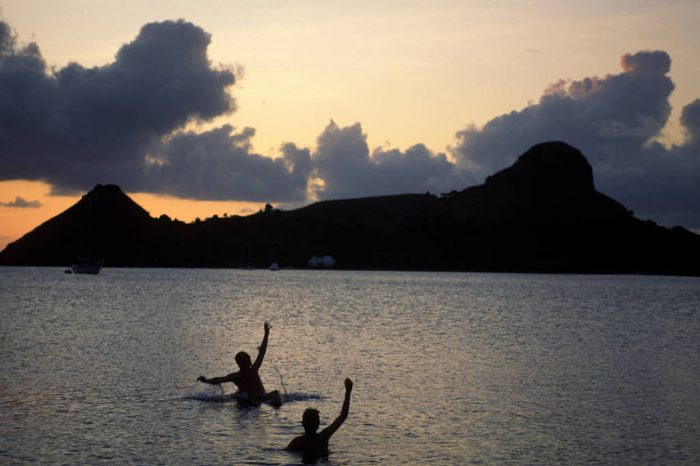 Photo: Swimmers wave a greeting in St. Lucia, the Caribbean.