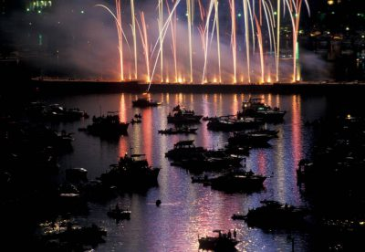 Photo: Fireworks explode over the Charles River in time with a Boston Pops performance on July 4th.