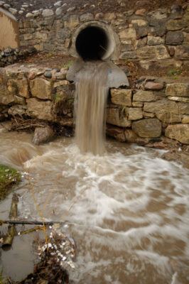 Photo: Storm sewer water rushes from the streets of Santa Fe into a stream near the city's downtown.