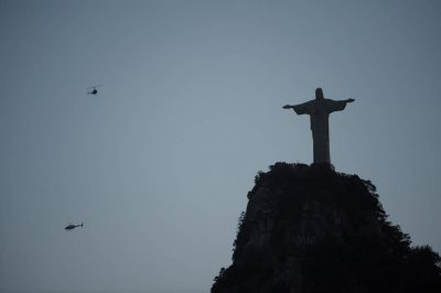 Photo: Helicopters fly by the Christ the Redeemer Statue in Rio de Janeiro, Brazil.