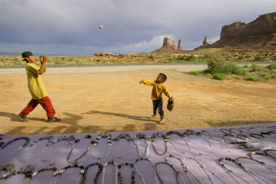 Photo: Navajo natives sell necklaces (and play catch) in Monument Valley, Utah.