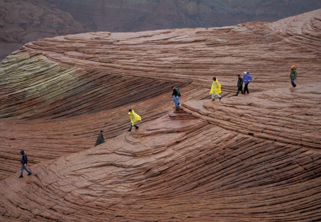 Photo: A boy scout troop hikes on sandstone rock formations at Snow Canyon State Park, Utah.