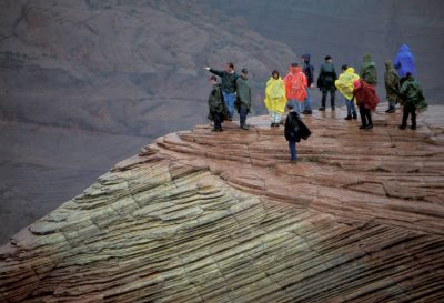 Photo: A tourist group hikes on sandstone rock formations at Snow Canyon State Park, Utah.