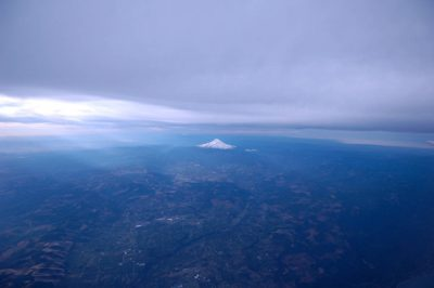 Photo: The volcanic peak of Mt. Hood rises up near the Columbia River in Oregon.