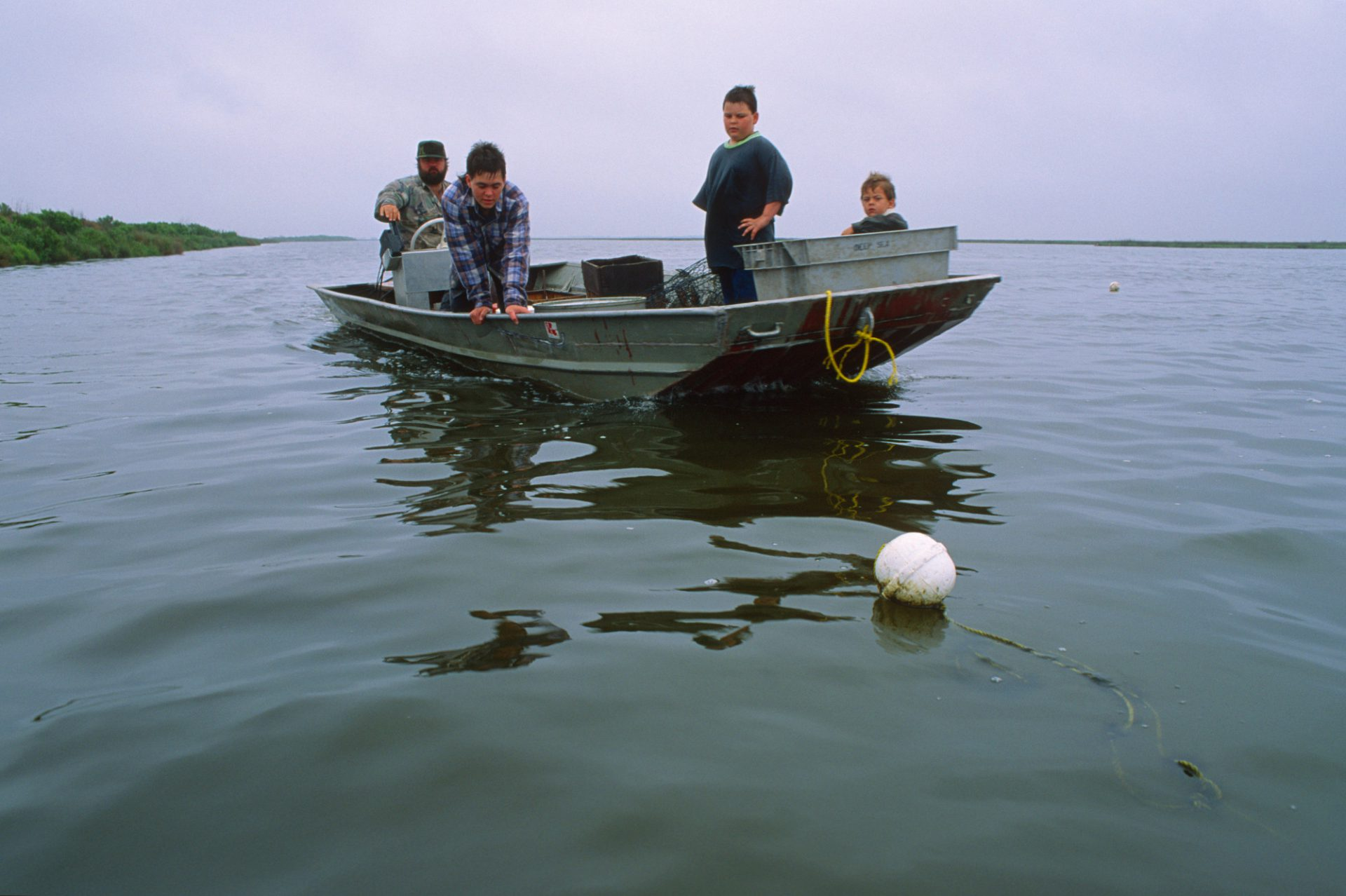 Photo: A man and his sons go fishing along the gulf coast.