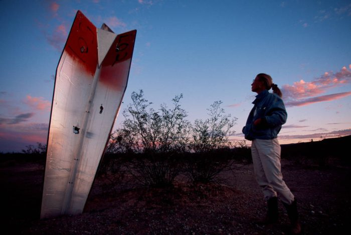 Photo: A tourist surveys darts used by the military as targets in practice flights over Cabeza Prieta NWR, Arizona.