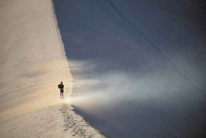 "Photo: Tourist on sand dunes in ""The Valley of the Moon"" in Chile's Atacama Desert, the driest place on earth."