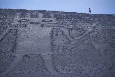 Photo: El Gigante, a geoglyph in the Atacama Desert between Iquique and Arica on the Panamerican highway in Chile.