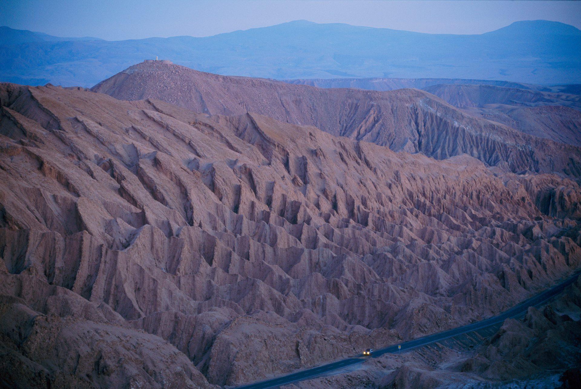 Photo: The desert dwarfs the one road from Calama to San Pedro de Atacama.