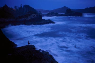 Photo: Overview of Chesterman Beach near Tofino, British Columbia (in Clayoquot Sound) at dusk, with a rough tide coming in.