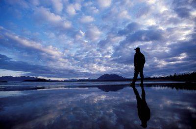 Photo: A man looks out over the tide-line at Vargas Island at dawn.