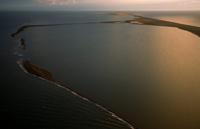 Photo: A barrier island near Point Lay separates Kasegaluk Lagoon from the Arctic Ocean near Point Lay. This lagoon is home to beluga whales, bowhead whales and seals.