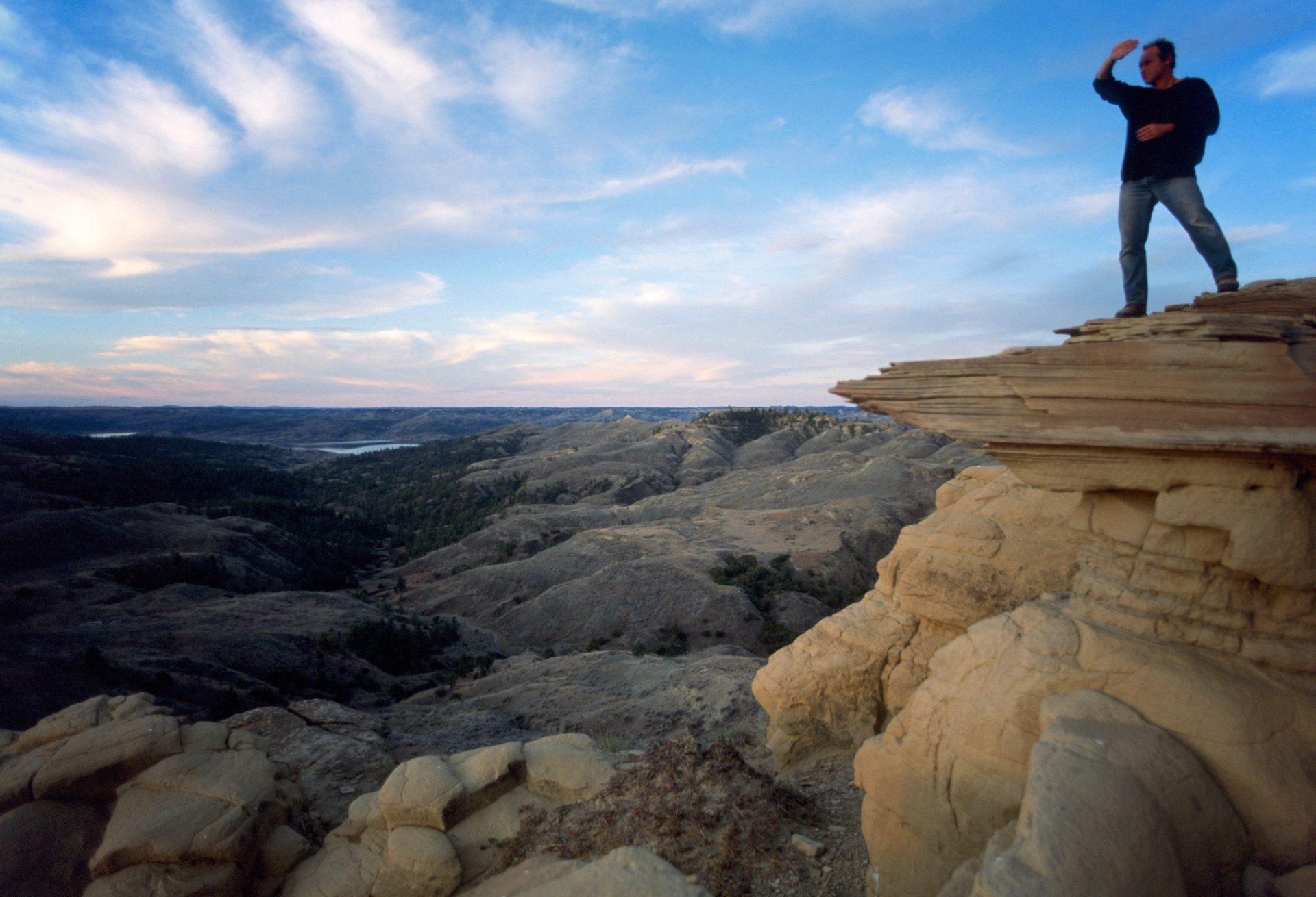 Photo: A man looks out over the landscape of the Charles M Russell Refuge, Montana.