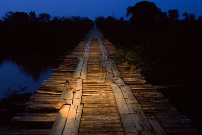 Photo: A rickety wooden bridge spans a marshy area on the Transpantaniera highway in Brazil's Pantanal region.