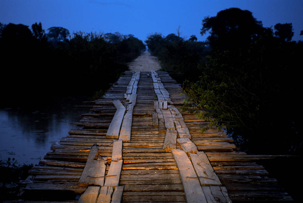 Photo: A rickety wooden bridge spans a marshy area on the Transpantaniera highway in Brazil's Pantanal region.