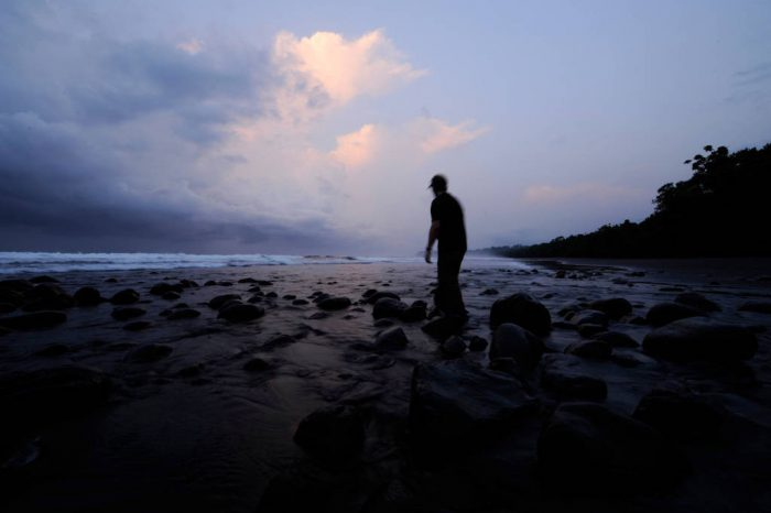 Photo: A man walks along the beach on the south coast of Mexico, near Playa Tortuga.