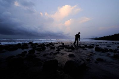 Photo: A man walks along the beach on the south coast of Mexico, near Playa Tortuga.
