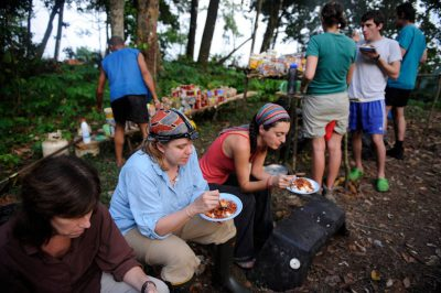 Photo: A crew of researchers eats dinner at turtle camp on Bioko Island, Equatorial Guinea, Africa.