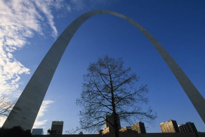 Photo: The St. Louis Arch with buildings in the background.