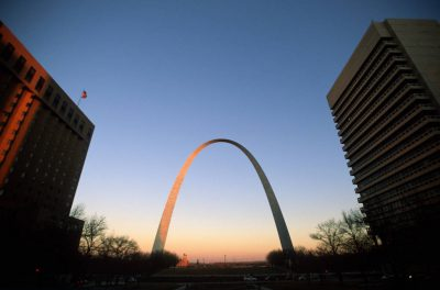 Photo: The St. Louis Arch with buildings in the foreground.