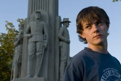 Photo: A teenage boy at Antelope Park's war veterans memorial in Lincoln, Nebraska.