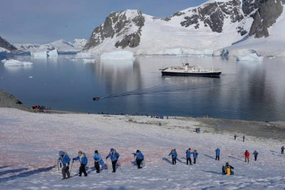 Photo: Ecotourists and the National Geographic Endeavor, Danco Island, Antarctica.
