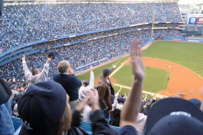 Photo: Fans cheer during a New York Yankees baseball game.