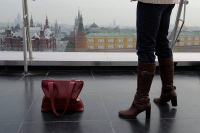 Photo: A woman on the Ritz Carlton rooftop in downtown Moscow, Russia.