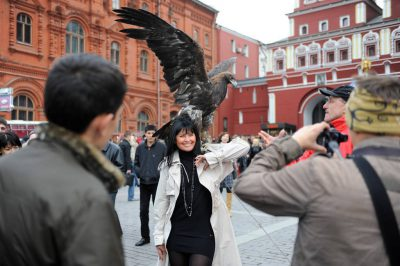Photo: A vendor sells the opportunity to have a photo taken with an eagle to visitors just outside of Red Square in Moscow, Russia.