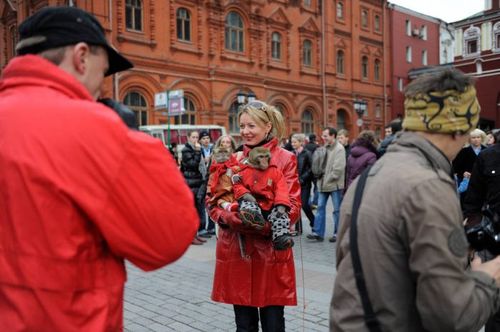 Photo: A vendor sells the opportunity to have a photo taken with his two monkeys to visitors just outside of Red Square in Moscow, Russia.