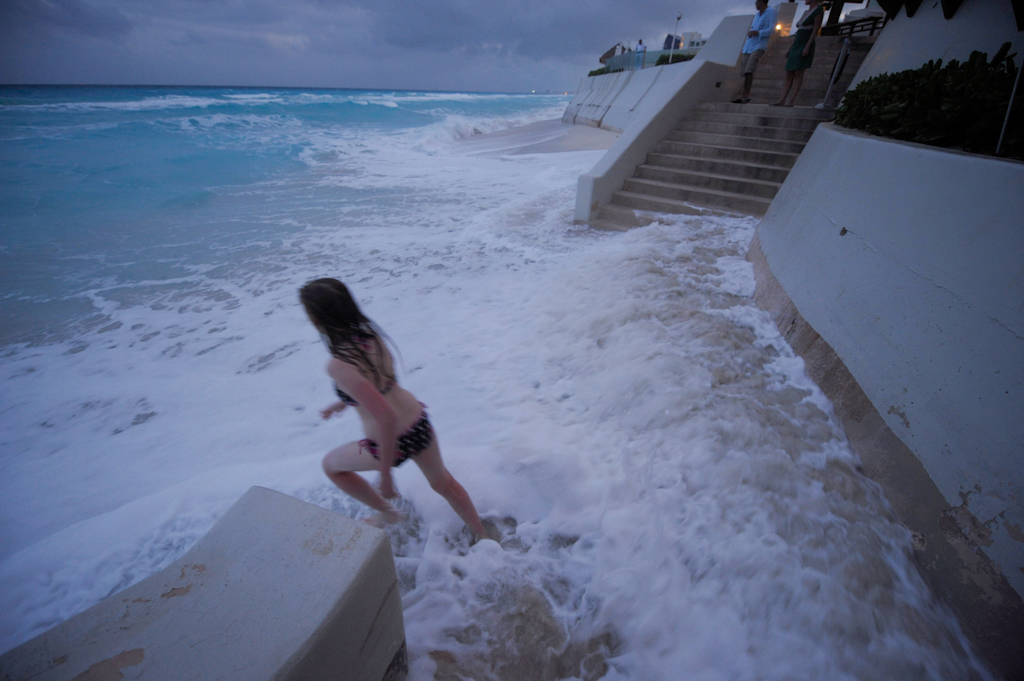 Photo: A twelve year-old girl on the shores of Mar Caribe peninsula, Cancun, Mexico.