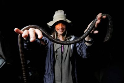 Photo: A woman holds a giant earthworm in the cloud forest reserve of Reserva Las Gralarias, near Mindo, Ecuador.