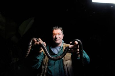 Photo: Joel Sartore holds a giant earthworm in the cloud forest reserve of Reserva Las Gralarias, near Mindo, Ecuador.