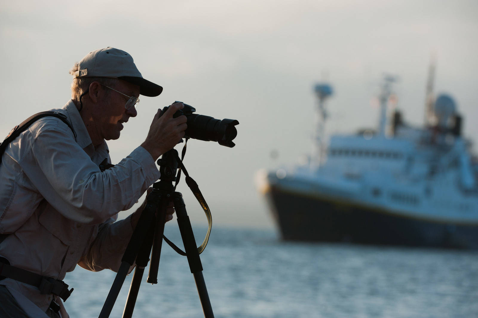 Photo: A man takes pictures in the Galapagos Islands.