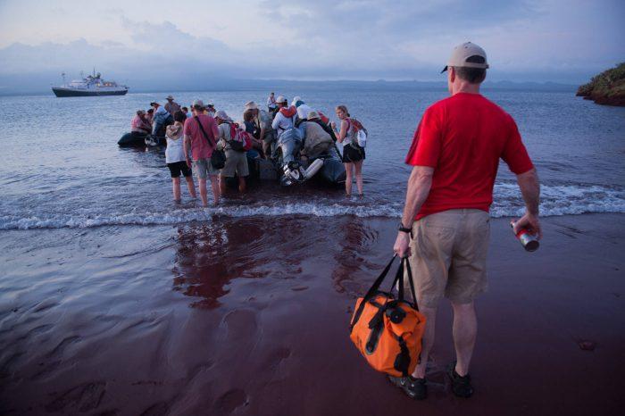 Photo: Visitors to Rabida in the Galapagos Islands.