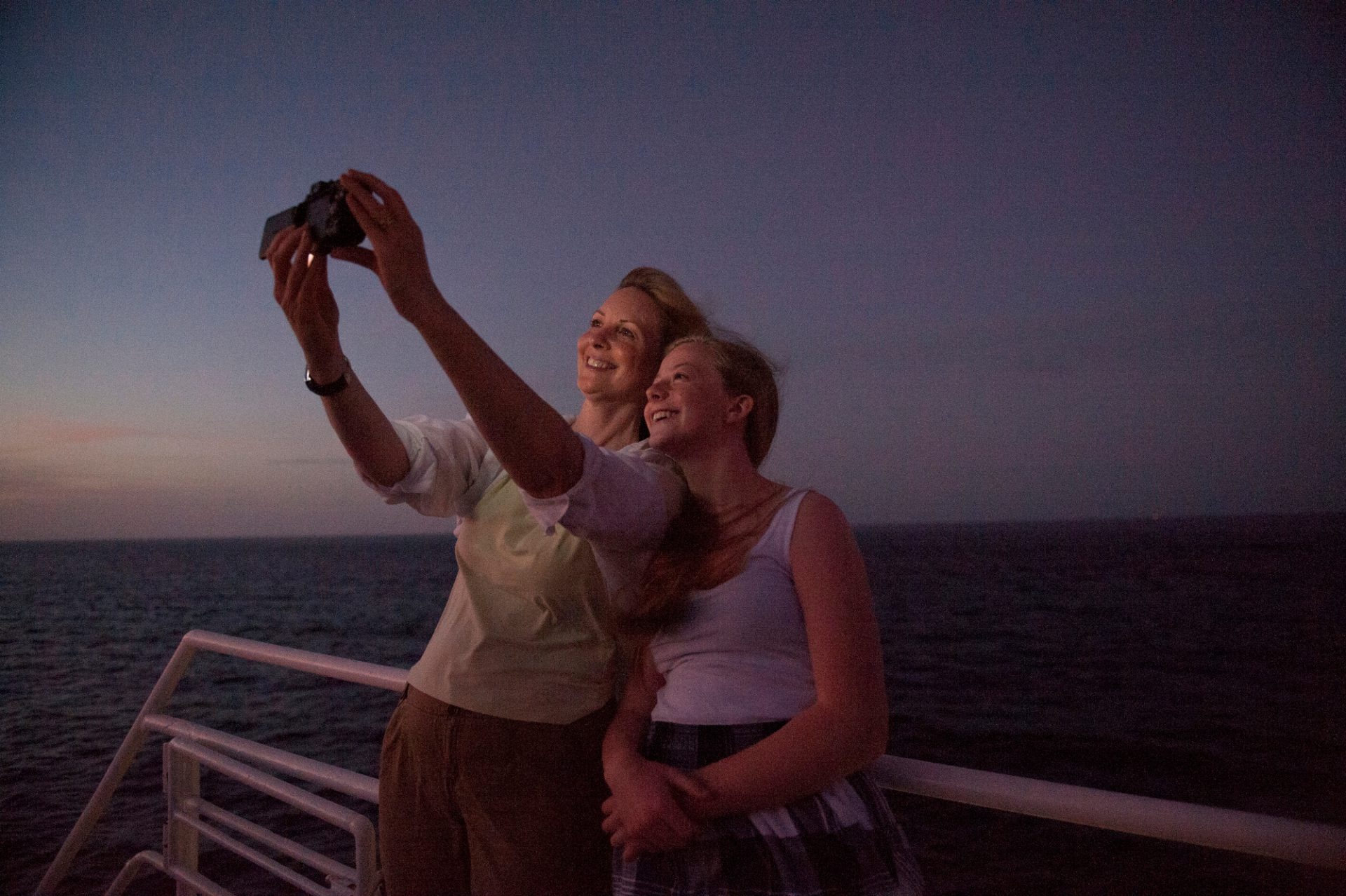Photo: A mother and daughter take a picture of themselves as they cross the Equator, near Isabella Island in Galapagos National Park.