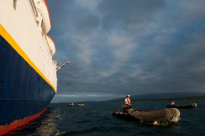 Photo: Zodiac boats depart from a cruise ship near Isabela Island in Galapagos National Park.