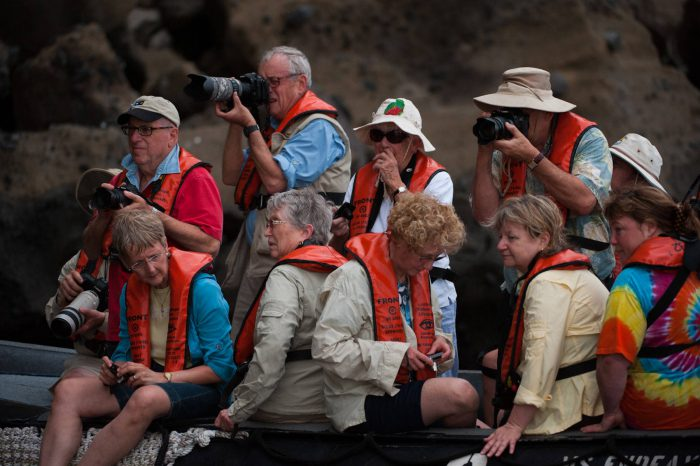 Photo: Tourists at Tagus Cove in Galapagos National Park.