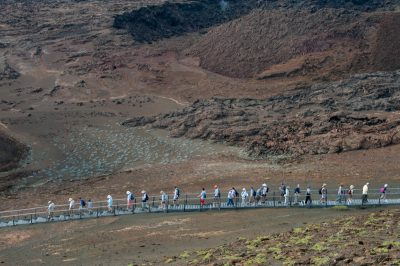 Photo: Tourists use the boardwalks, that are designed to protect the island's fragile surfaces, on Bartholomew Island.
