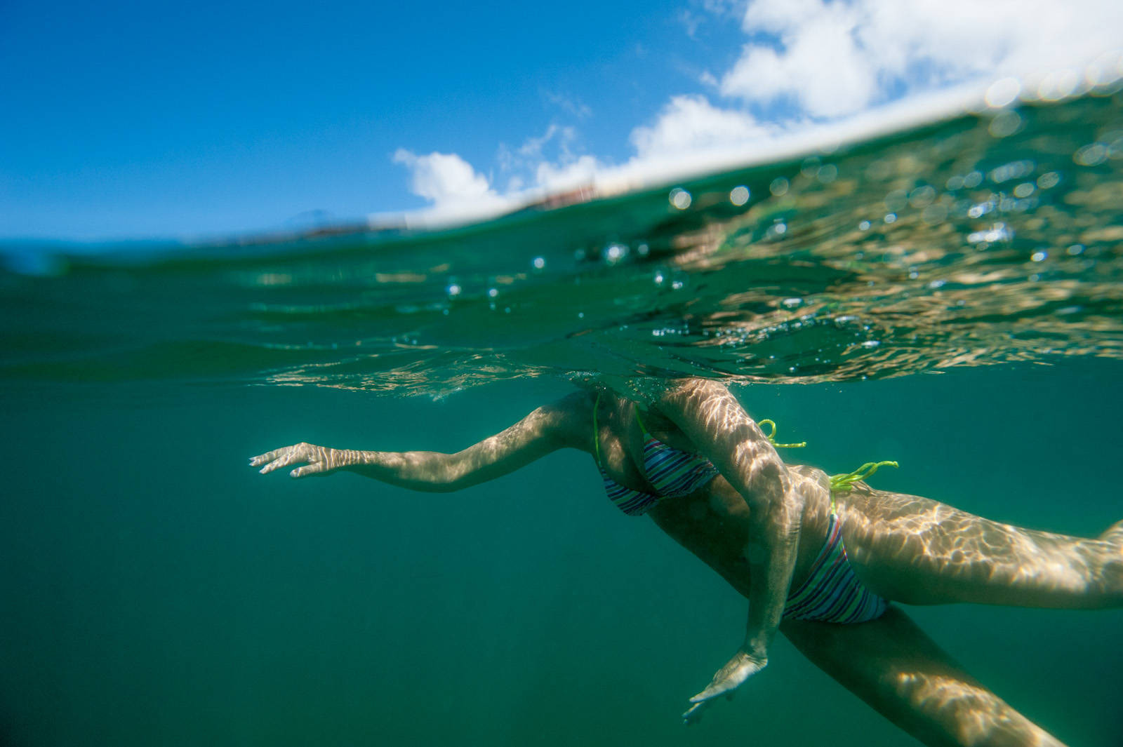 Photo: A woman swims along the Galapagos Islands.