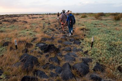 Photo: Tourists follow the trails on Espanola Island in Galapagos National Park.
