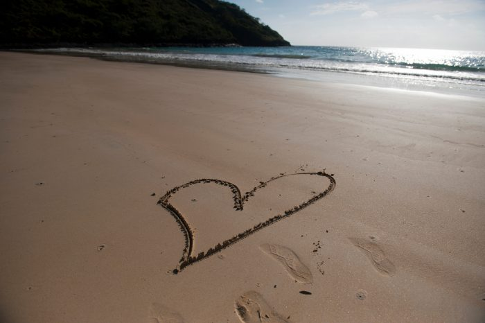 Photo: A heart is drawn in the sand on Floreana Island in Galapagos National Park.