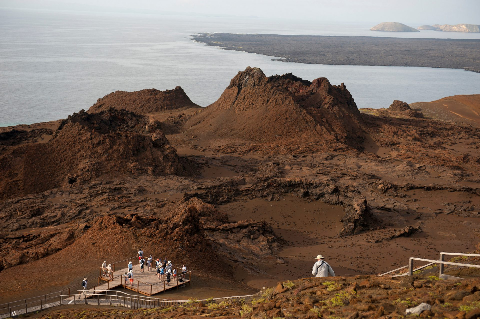 Photo: Tourists explore Bartholomew Island, part of Galapagos National Park.