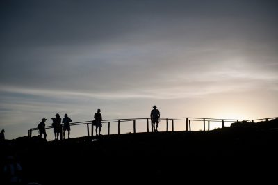 Photo: Silhouette of tourists using the boardwalks on Bartholomew Island, part of Galapagos National Park.