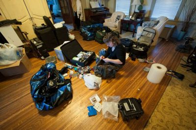 Photo: An assistant packs for a photographer's trip to Africa.