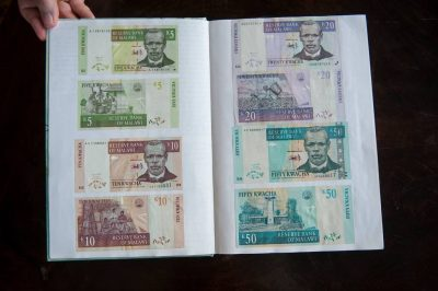 Photo: A journal documenting various kwacha (currency of Zambia).