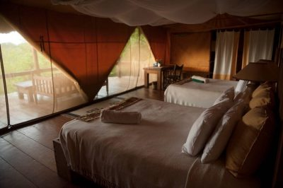 Photo: The sleeping quarters of a safari lodge in Uganda, Africa.