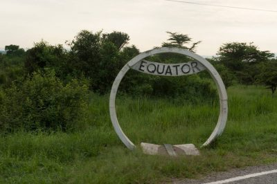 Photo: A sign marks the equatorial line along the road near Queen Elizabeth National Park in Uganda, Africa.